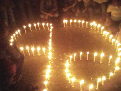 A candle light vigil portraying 71 in Bengali numbers. The spirit of 1971 is protesters' greatest strength.