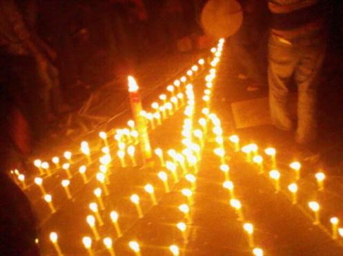 A candle light vigil portraying Jatiyo Smrityshoudha, national martyrs monument.