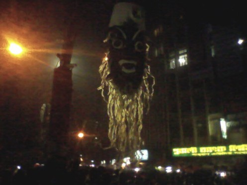 An effigy is hanging on a lamppost.