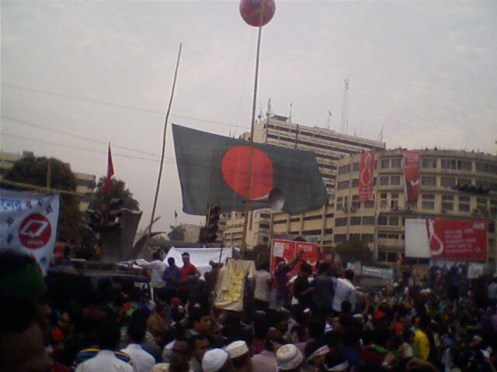A huge national flag is flying over one of the intersections at projonmo chottor (Shahbag).