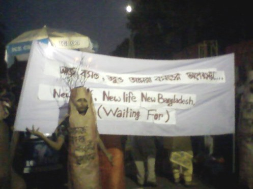According to Bengali calendar, today is the first day of spring. A group of protesters, dressed in tree-shaped costume, has recourse to stage an innovative protest at the entrance of Institute of Fine Arts, Dhaka University.  The background banner reading  'Today is the first day of spring, But we have still been waiting for spring.'